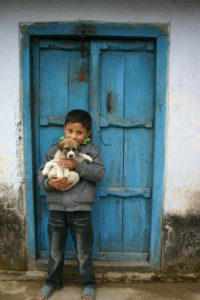 Nepalise boy with dog